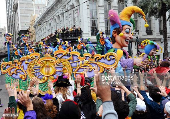 Large crowds reach up for beads as the Jester float in the traditional Rex parade rolls down Canal Street on Mardi Gras March 8 2011 in News Orleans...