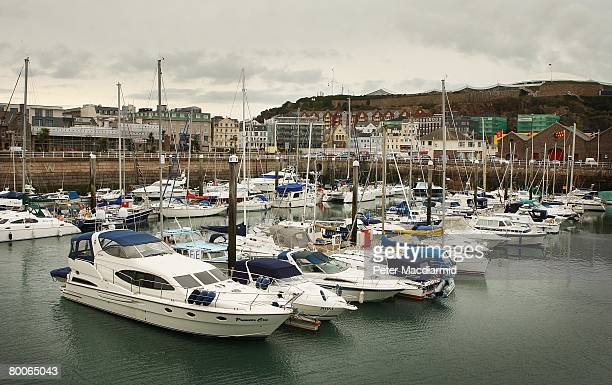 Large cruisers and yachts line St Helier harbour on February 28 2008 in Jersey Channel Islands Police on the island of Jersey are continuing to...