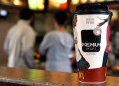 A large cup of McDonald's new 'Premium Roast' brand coffee is displayed at a McDonald's restaurant February 28 2006 in Rosemont Illinois McDonald's...