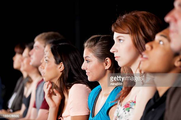 Large diverse audience of teenagers at a show