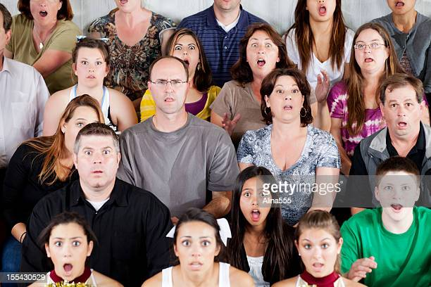 Large diverse group of people shocked at the game