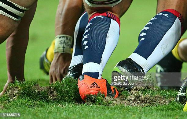 Large divots of turf are ripped up during a scrum during the round eight Super Rugby match between the Rebels and the Hurricanes at AAMI Park on...