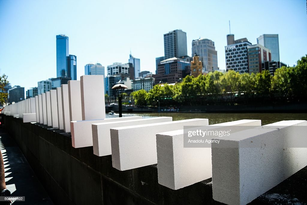 Large Dominoes being setup during the Arts Centre Melbournes Dominoes arts project in Melbourne, Australia February 6, 2016. More than 7000 giant dominoes snaked through Melbourne city over 2km.