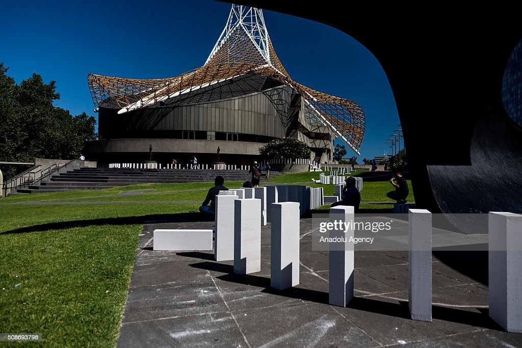 Large Dominoes on display before being collapsed outside the Arts Centre Spire during the Arts Centre Melbournes Dominoes arts project in Melbourne, Australia, on February 6, 2016. More than 7000 giant dominoes snaked through Melbourne city over 2km.