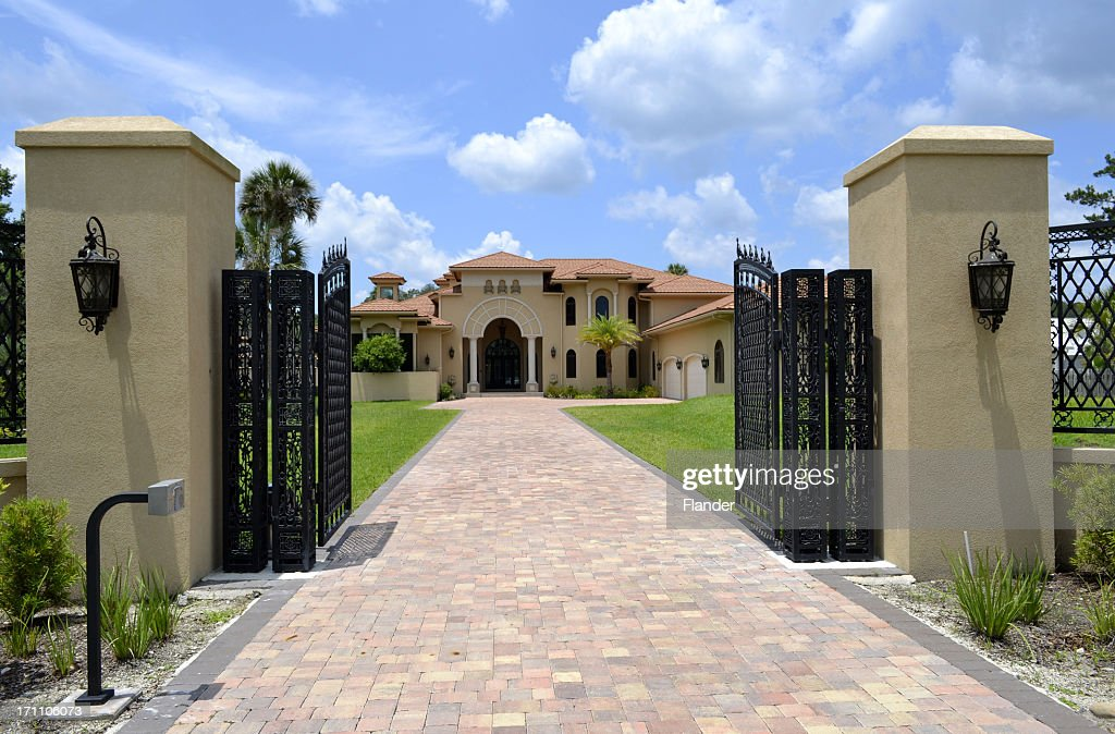 Large driveway and gate to Florida home