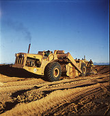 A large earth mover at work constructing a road