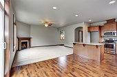 Large empty living room interior connected with kitchen room. Open plan.