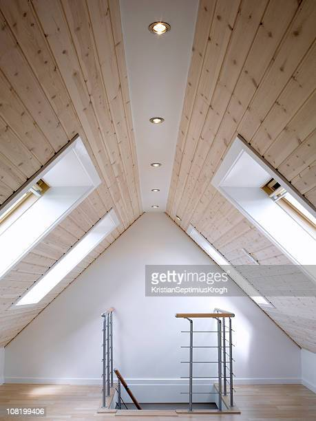 A large empty loft with wooden ceilings