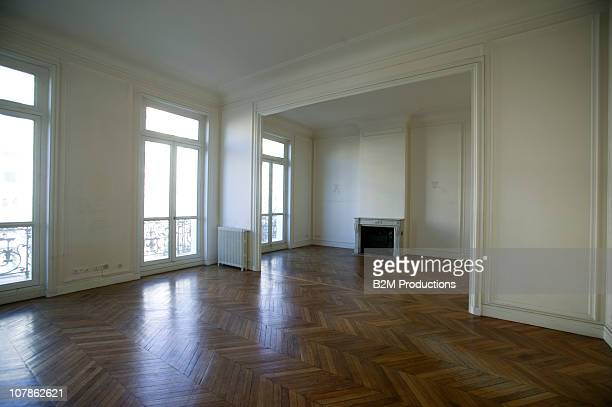 Large Empty Room with Wooden Floors
