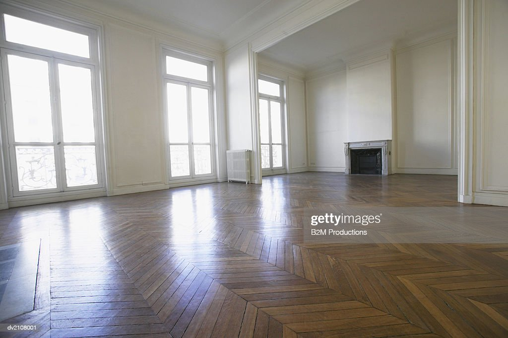 Large Empty Room with Wooden Floors : Stock Photo