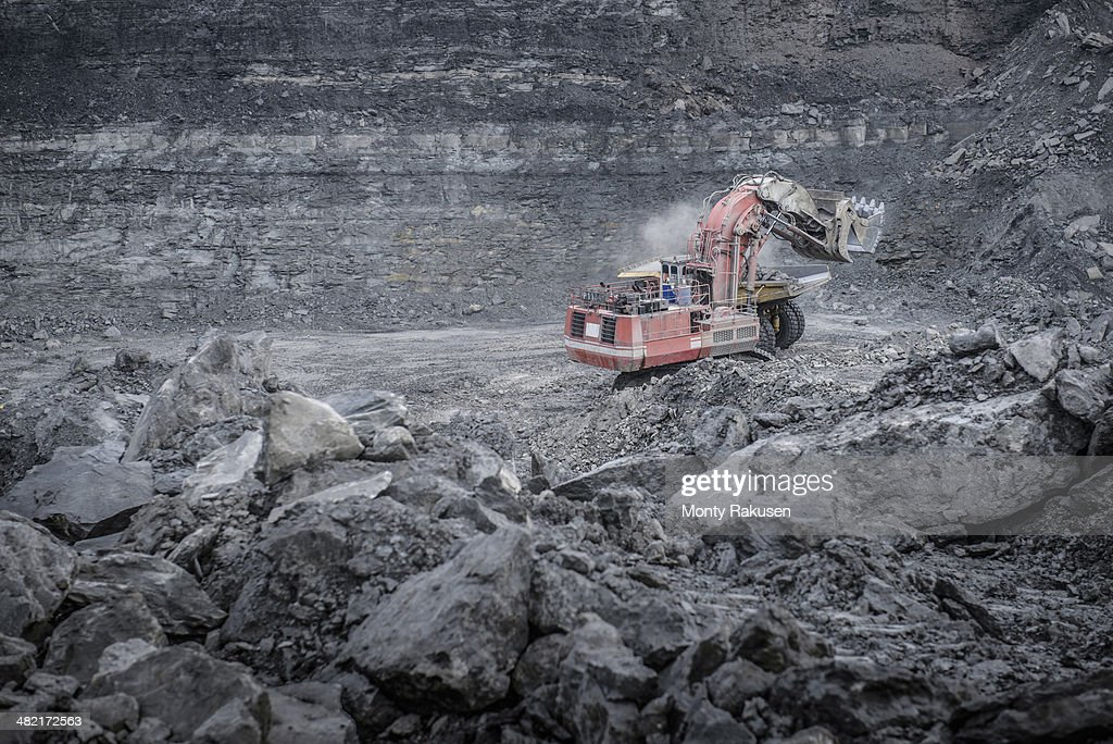 Large excavator and geological strata in surface coal mine