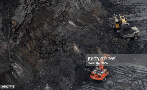 A large excavator loads a truck with oil sands at the Suncor mine near the town of Fort McMurray in Alberta on October 23 2009 Greenpeace are calling...