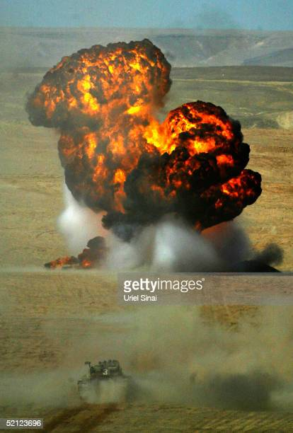 A large explosion rocks the desert during a combined forces exercise on February 2 2005 at Shezafon training base on southern Israel Infantry armor...