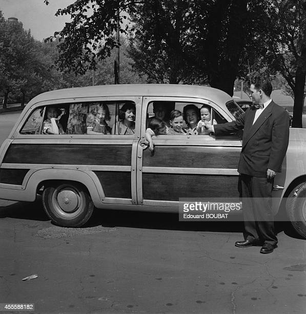 Large family during a car ride 1953 in Pittsburgh Pennsylvania