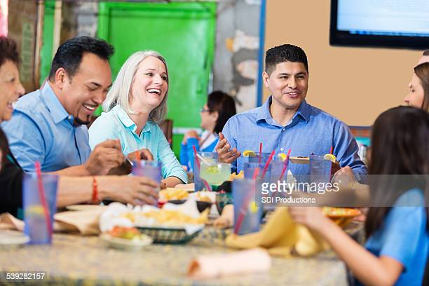 Large family eating meal in restaurant together