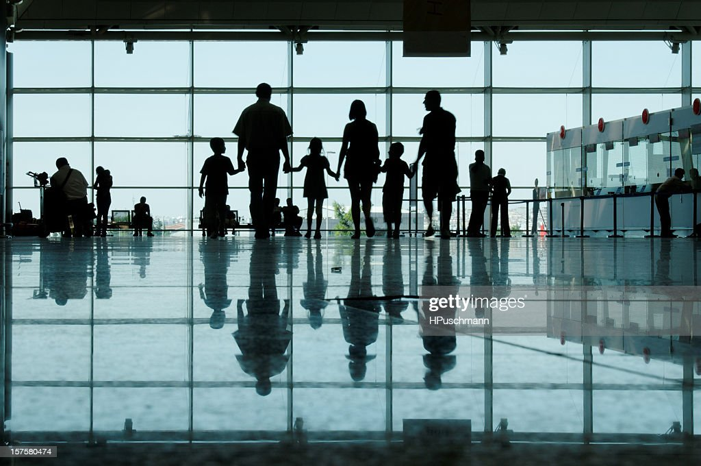 Large family on an airport concourse : Stock Photo