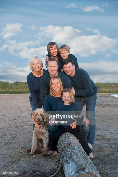 Large family portrait on beach with dog