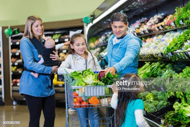 Large family shopping for groceries together in supermaket