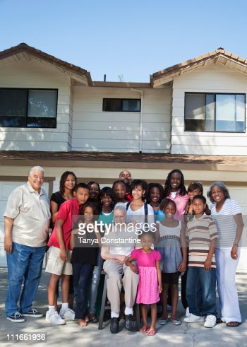 large family standing in front of house stock photo getty images. Black Bedroom Furniture Sets. Home Design Ideas