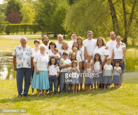 Large family standing outdoors, smiling, portrait