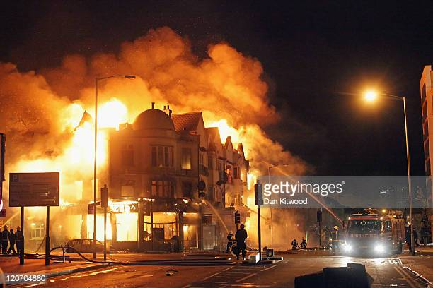 A large fire breaks out in shops and residential properties in Croydon on August 9 2011 in London England Sporadic looting and clashes with police...