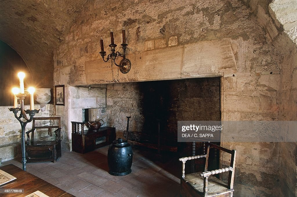 Large Fireplace In The Dungeon Room In Chateau Of Turenne