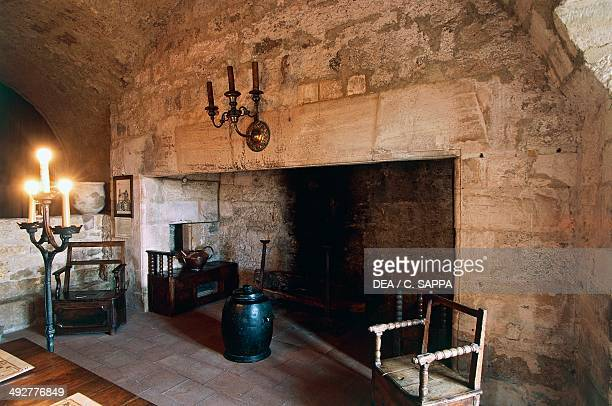 Large fireplace in the dungeon room in Chateau of Turenne 14th century Limousin France