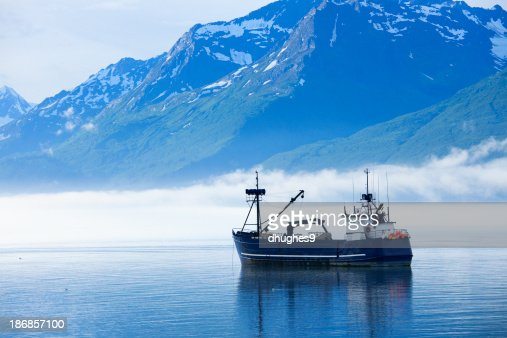 Large fishing boat anchored in valdez alaska bay stock for Large fishing boats