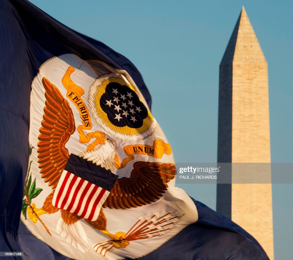 A large flag with The Great Seal of the United States flies over the US Department of State with the Washington Monument in the background February 6, 2013, in Washington, DC. The Great Seal of the United States is used to authenticate certain documents -- such as treaties -- issued by the United States federal government. AFP PHOTO/Paul J. Richards