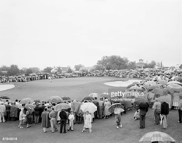 A large gallery watches Ben Hogan on the 18th hole during the 1956 Masters Tournament at Augusta National Golf Club in April 1956 in Augusta Georgia