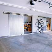 Large Garage with Sliding Doors to Storage Space
