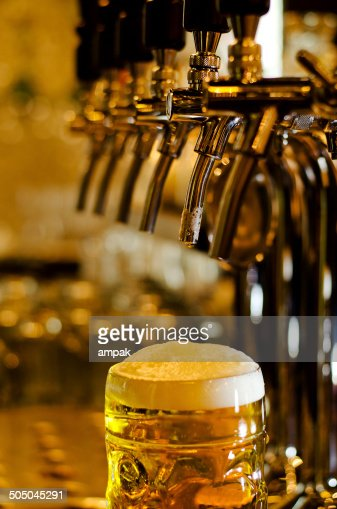 Large glass tankard of draught beer : Stock Photo
