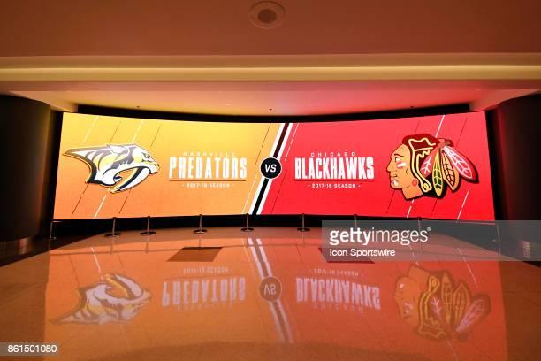 A large graphics monitor displays the Chicago Blackhawks vs Nashville Predators logos during a game between the Chicago Blackhawks and the Nashville...