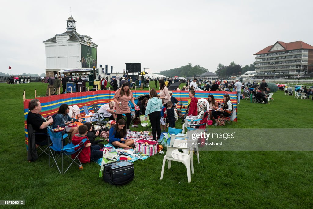 A large group enjoy the day in the Course Enclosure at York racecourse on August 23, 2017 in York, England.