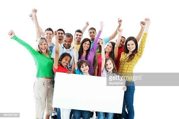 Large group holding a big white board.