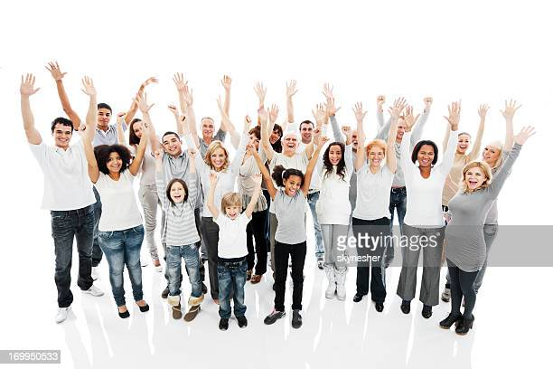 Large group of a happy people with raised hands.