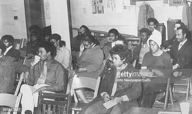 Large group of AfricanAmerican men and women seated in rows waiting to register to vote January 4 1958