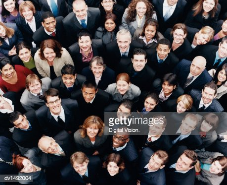 Large Group of Business People Standing and Looking up at Camera : Stock Photo
