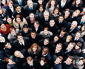 Large Group of Business People Standing and Looking up at Camera