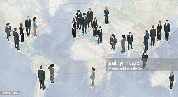 Large group of business people standing on world map