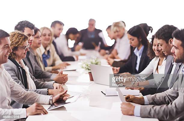 Large group of business people working at the table.