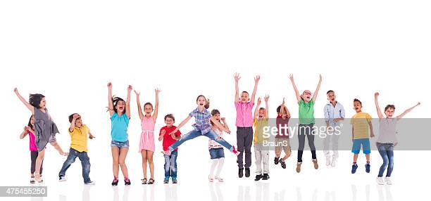 Large group of cheerful kids jumping together. Isolated on white.
