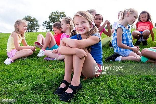 Large Group Of Children Sitting on the Grass