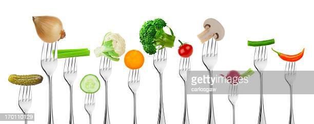Large group of different vegetables on forks