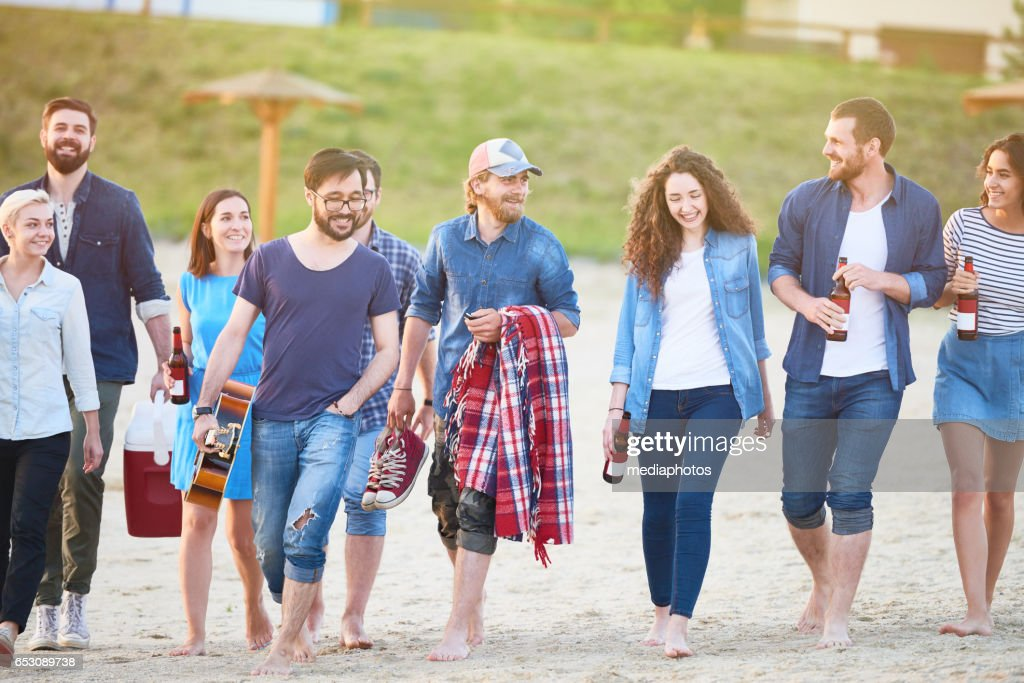 Large group of friends walking : Stock Photo