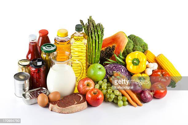 Large group of groceries arranged neatly on white table