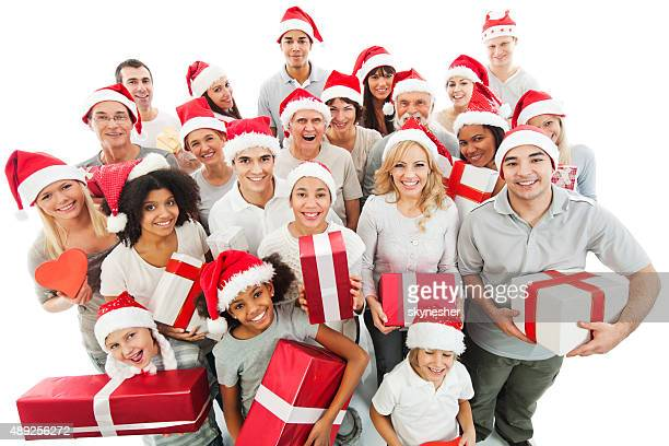 Large group of happy people holding Christmas presents.