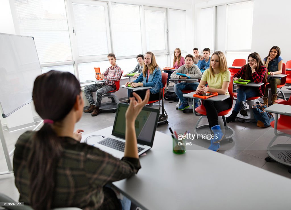 Large group of high school students attending a modern class. : Stock Photo
