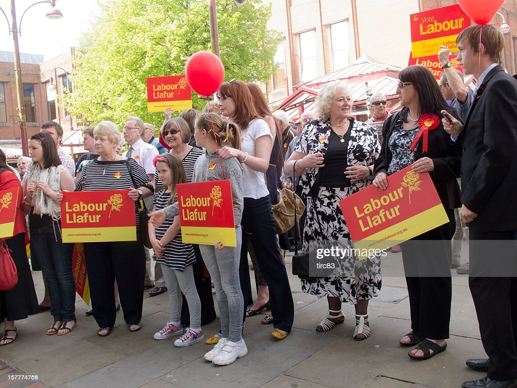 Large group of Labour Party supporters at an election rally : Stock Photo