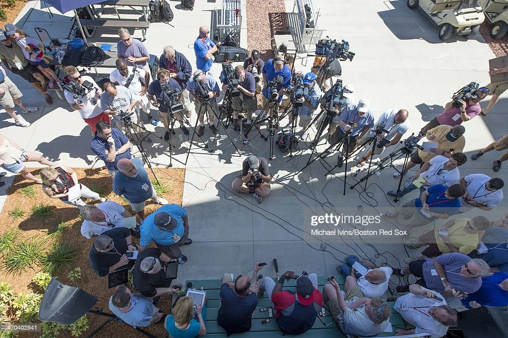 A large group of media gathers around David Ortiz #34 of the Boston Red Sox during a press conference at Fenway South on February 19, 2014 in Fort Myers, Florida.